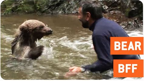 Man Plays with a Bear in Stream   Best Friends - YouTube
