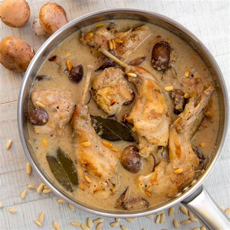 RABBIT STEW braised in white wine with mushrooms and